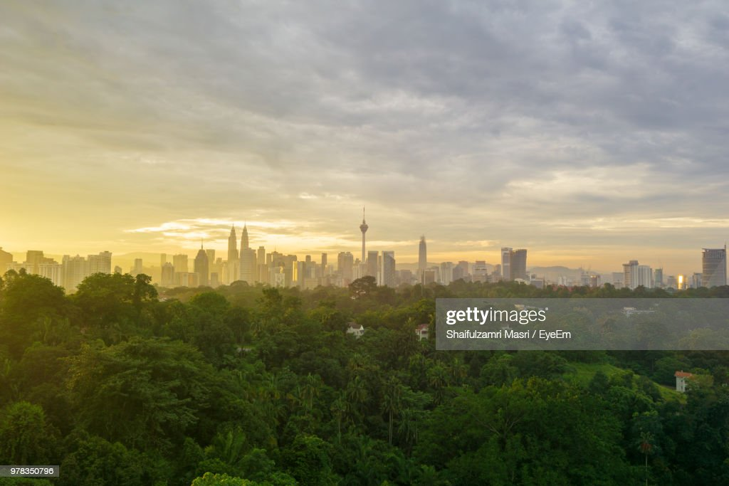 Trees And Buildings Against Sky During Sunset : Stock Photo