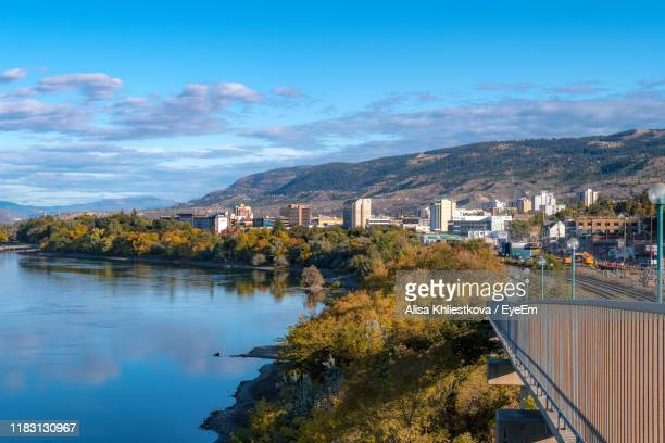 trees and buildings against sky - kamloops stock pictures, royalty-free photos & images