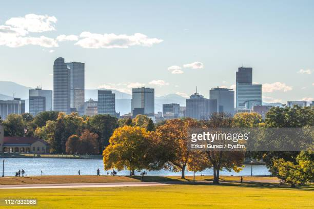 trees and buildings in city against sky - denver stock pictures, royalty-free photos & images