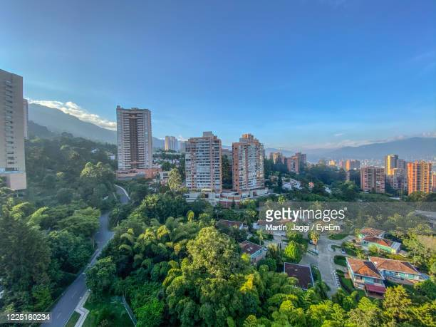 trees and buildings in medellin colombia against sky - medellin colombia stock pictures, royalty-free photos & images