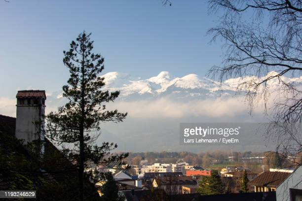 trees and buildings in town against sky - vaduz stock pictures, royalty-free photos & images