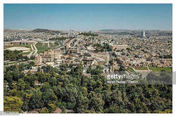 trees and cityscape against sky - şanlıurfa stock pictures, royalty-free photos & images