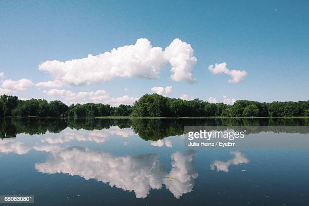 Trees And Sky Reflecting On Mississippi River