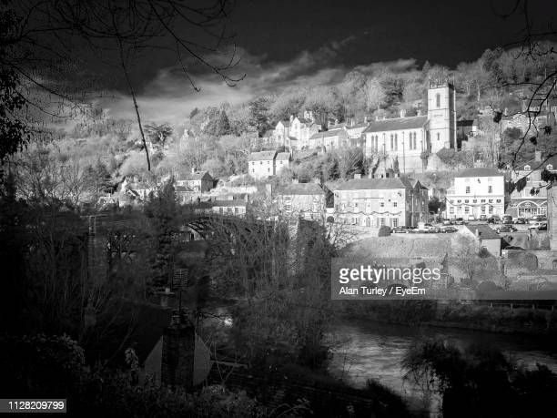 trees and townscape against sky at dusk - ironbridge shropshire stock pictures, royalty-free photos & images