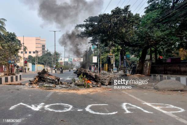 TOPSHOT Trees are burning in the middle of a road during a curfew in Guwahati on December 12 following protests over the government's Citizenship...