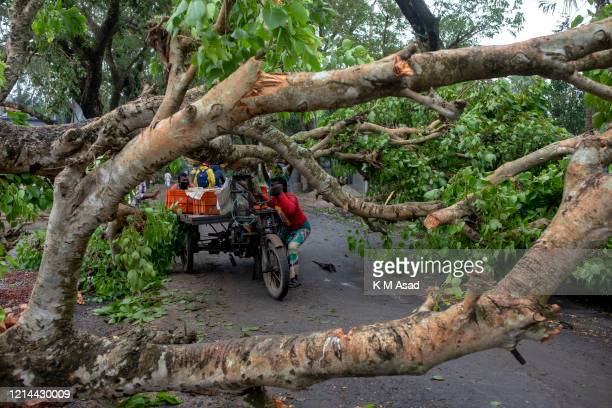 SHATKHIRA KHULNA BANGLADESH Trees block the road after the landfall of cyclone Amphan in Satkhira At least 15 people in Bangladesh and 72 people in...