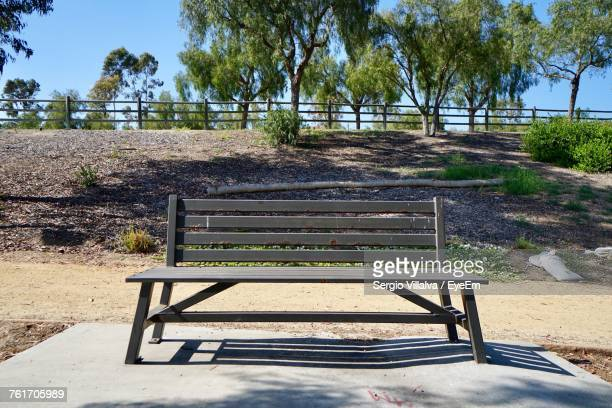 trees in park against sky - park bench stock pictures, royalty-free photos & images