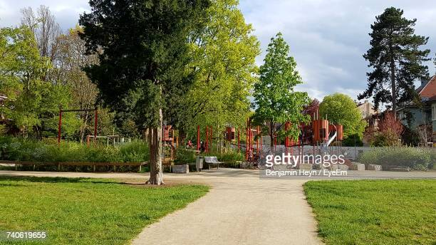 trees in park - kids playground stock photos and pictures