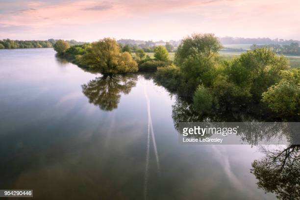 trees reflected in a river photographed from an elevated view - loire valley stock pictures, royalty-free photos & images