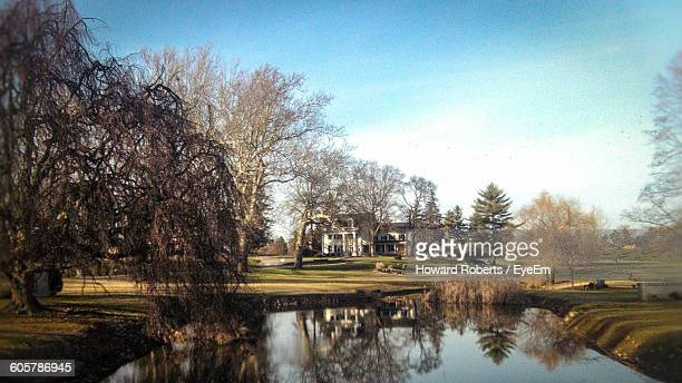 trees reflection in pond against sky - howard,_wisconsin stock pictures, royalty-free photos & images