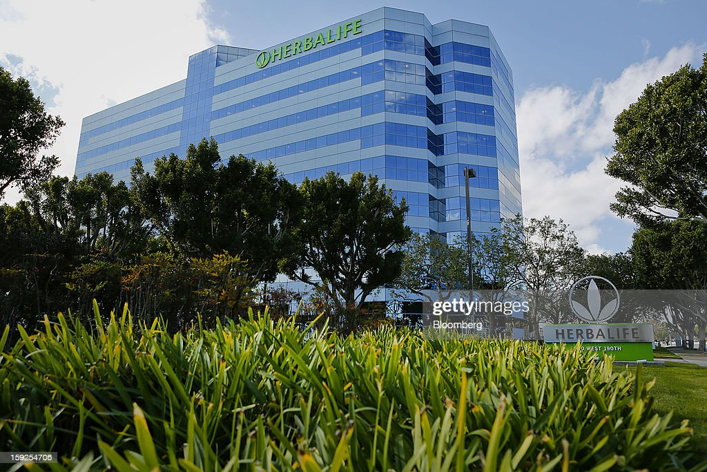Trees stand outside of the Herbalife Ltd. corporate headquarters in Torrance, California, U.S., on Thursday, Jan. 10, 2013. Daniel Loeb is squaring off against Bill Ackman over the future of Herbalife Ltd. By taking an 8.2 percent stake in the direct seller of nutrition shakes, Loeb's Third Point LLC is the latest firm to reject hedge fund manager Ackman's theory that Herbalife is a pyramid scheme. Photographer: Patrick Fallon/Bloomberg via Getty Images