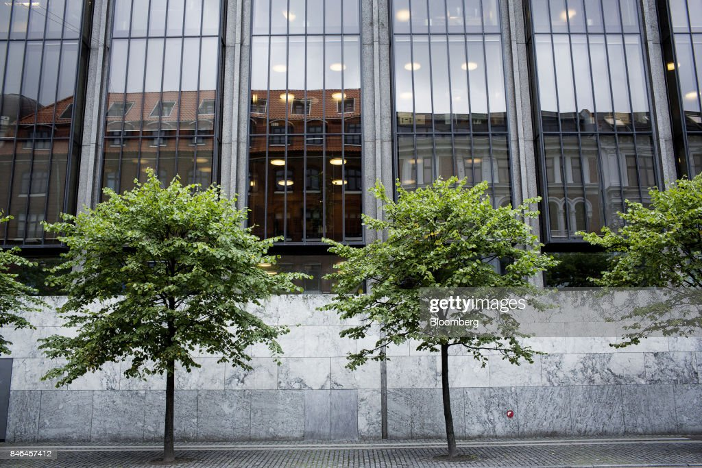 Trees stand outside the offices of Denmark's central bank headquarters in Copenhagen, Denmark, on Wednesday, Sept. 13, 2017. 'We have previously seen that the economy can overheat vigorously and suddenly when it is booming, Central Bank Governor Lars Rohdesaid in a statement on Wednesday.Photographer: Carsten Snejbjerg/Bloomberg via Getty Images