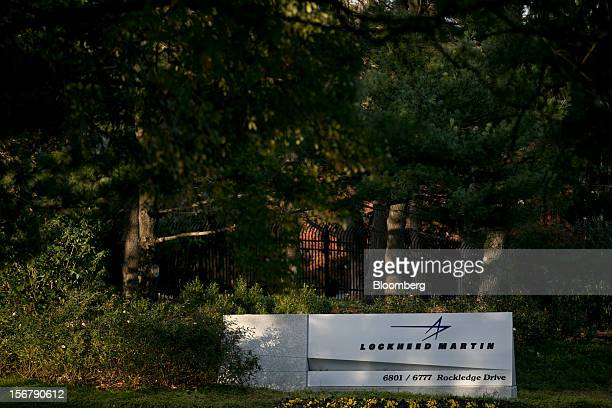 Trees surround a sign for Lockheed Martin Corp. Standing outside the company's headquarters in Bethesda, Maryland, U.S., on Friday, Nov. 16, 2012....