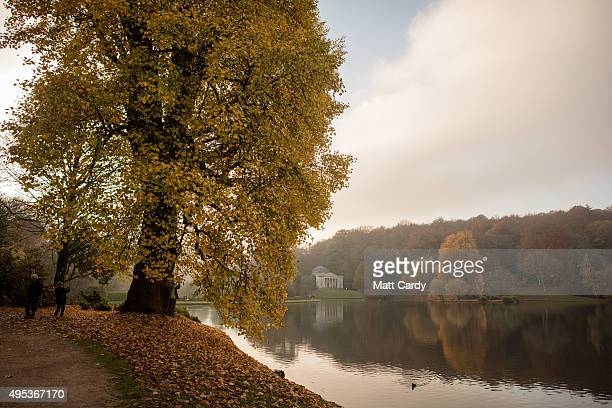 Trees surrounding the lake display their autumn colours at the National Trust's Stourhead on November 2 2015 in Wiltshire England Following a sunnier...