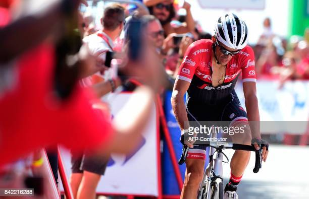 Trek Segafredo's Spanish cyclist Alberto Contador crosses the finish line of the 15th stage of the 72nd edition of 'La Vuelta' Tour of Spain cycling...