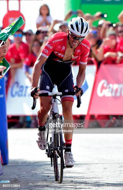 Trek Segafredo's Spanish cyclist Alberto Contador rides before crossing the finish line of the 15th stage of the 72nd edition of 'La Vuelta' Tour of...