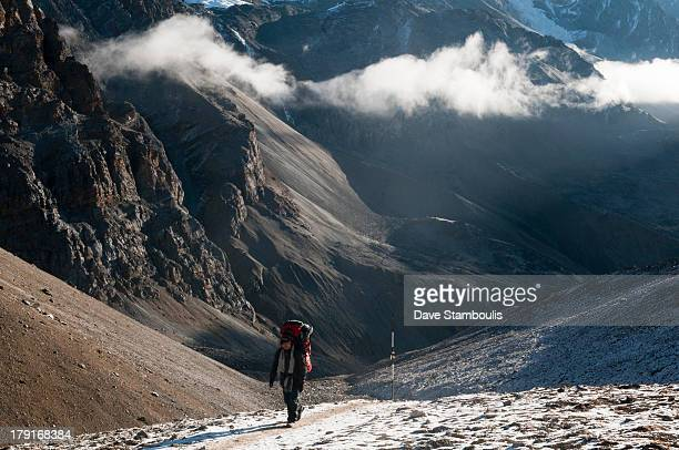 Trekker ascending the Thorung La Pass in the Annapurna region of Nepal