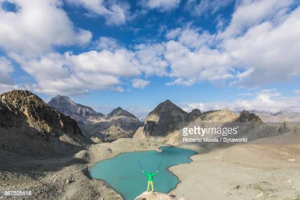 Trekker on rocks at Lej Lagrev, Switzerland