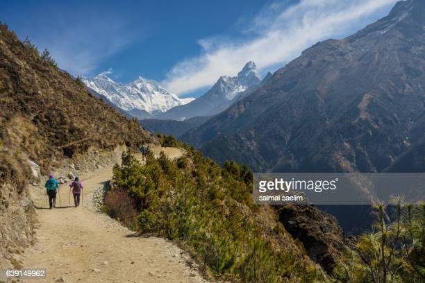 Trekker on the way to Everest base camp, with mountain in the background