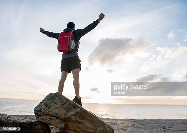 Trekker on top of a mountain