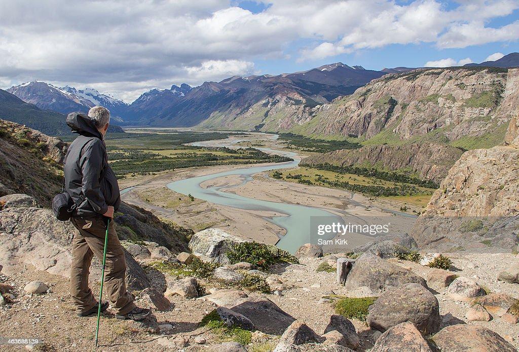 Trekker overlooking Rio de Las Vueltas : Stock Photo