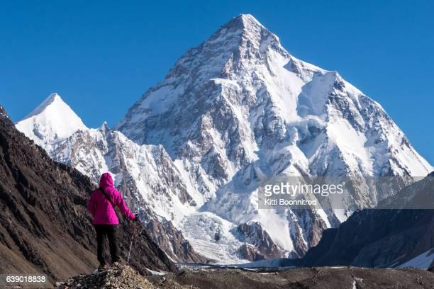 A trekker standing in front of Mt.K2, Pakistan