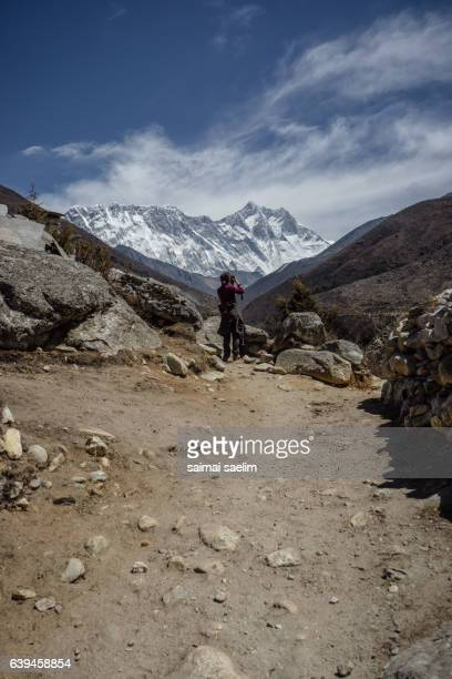 Trekker take a photo of Everest, Nuptse and Lhotse mountain peak