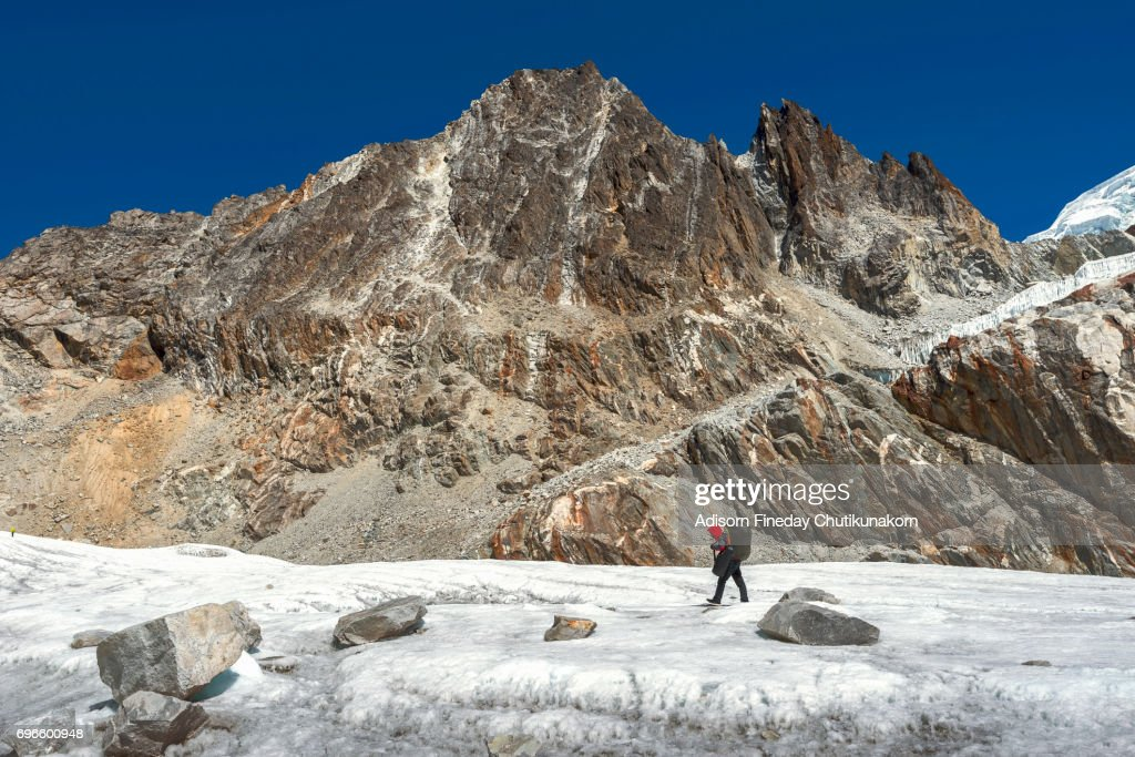 Trekker walk on Glacier at Chola pass, Everest region : Stock Photo