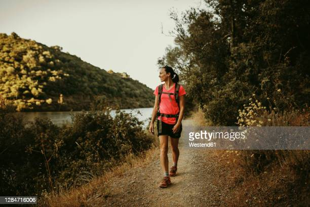 trekker walking on footpath at sierra de hornachuelos, cordoba, spain - andalucia stock pictures, royalty-free photos & images