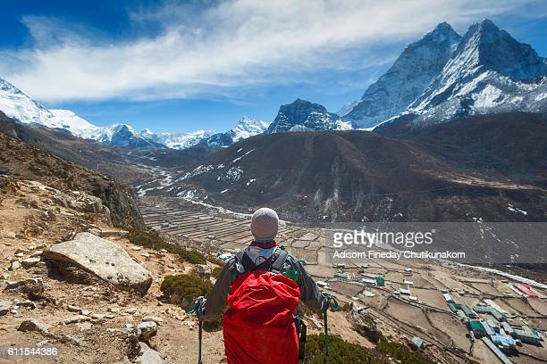 Trekker with Everest mountain background.