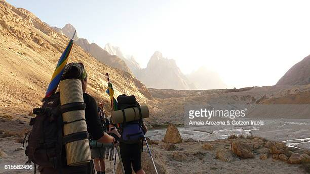 Trekkers getting to frontal moraine of Baltoro Glacier. Karakorum range, Pakistan.