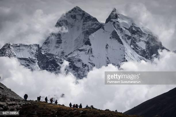 Trekkers in front of Kangtega mountain peak, Himalaya mountains range, Nepal