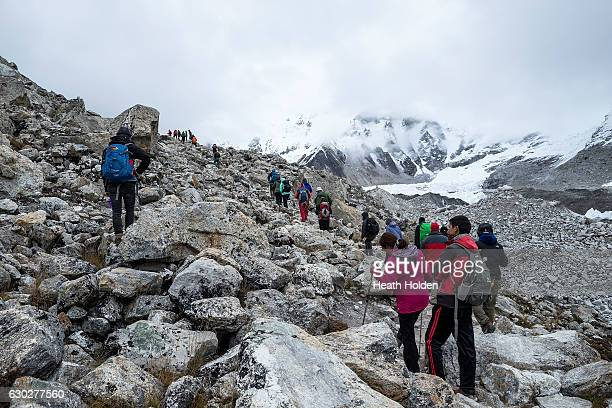 Trekkers making their way to Everest base camp although it is only at the base of the mountain it is a great acheivement to make it here The Khumbu...