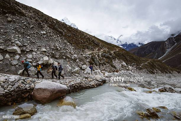 Trekkers on the trail to Dughla / Thukla which then leads them up the Khumbu valley and closer to Mt Everest on September 28 2016 in Dughla Nepal The...