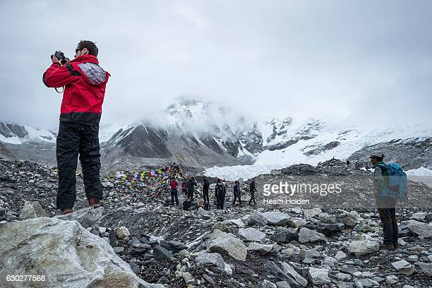 Trekkers taking photos at Everest base camp although it is 'only' at the base of the mountain it is a great acheivement to make it here The Khumbu...