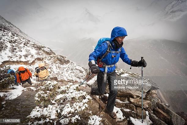 Trekkers walking on a high Himalayan trail in Everest region.