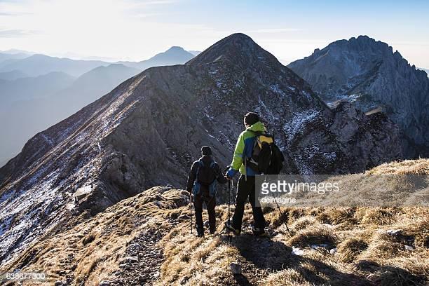 Trekkers walking on mountain up trail