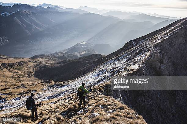 Trekkers walking on mountain up trail