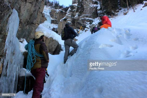 Trekker's walking on snow during the extreme winter sports event to reach the destination at Chandanwari in Pahalgam