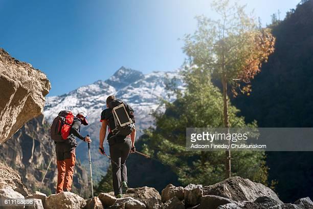 Trekkers walking on the way to Namche Bazaar