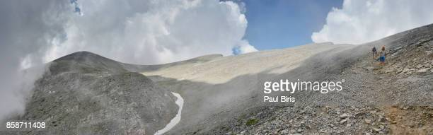 trekkers walking towards summit of mt olympus,  greece - thessaly stock pictures, royalty-free photos & images