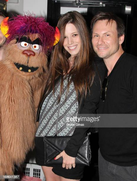 'Trekkie Monster' Brittany Lopez and fiancee Christian Slater pose backstage at the hit musical 'Avenue Q' on Broadway at The New World Stages on May...