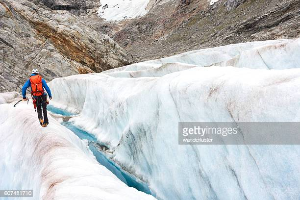 Trekking among crevasses on an icy glacier