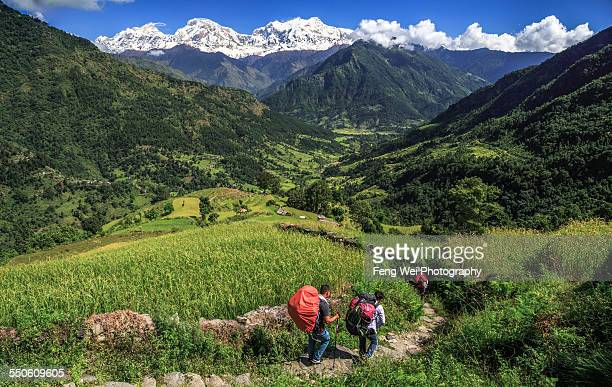 trekking in himalayas, annapurna circuit, nepal - annapurna conservation area stock photos and pictures