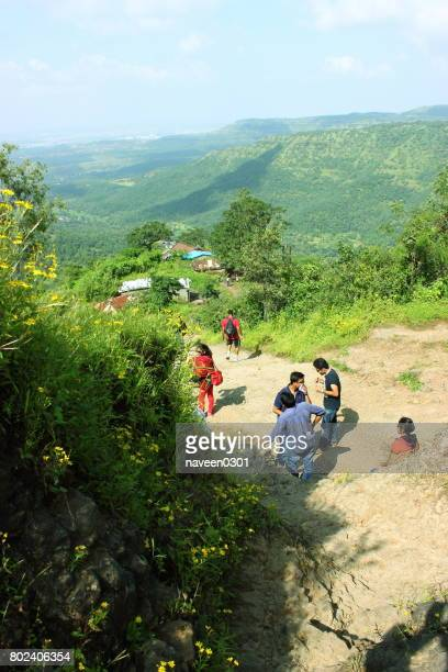 Trekking in nature surrounded with Green Hills