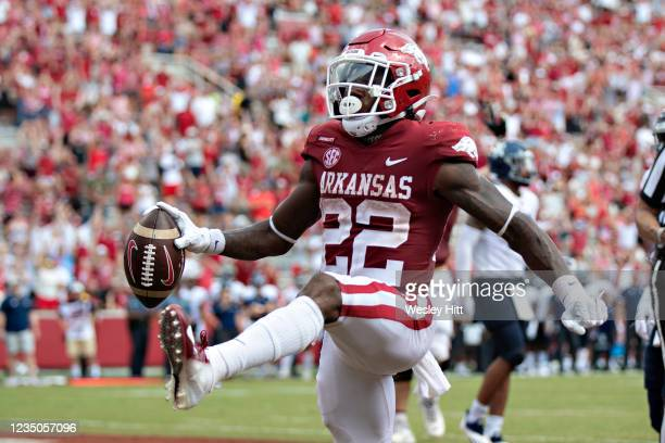 Trelon Smith of the Arkansas Razorbacks celebrates after scoring a touchdown in the second half of a game against the Rice Owls at Donald W. Reynolds...