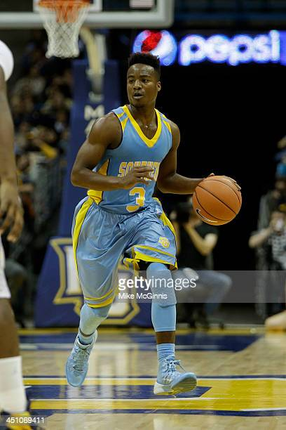 Trelun Banks of the Southern Jaguars dribbles up the court during the game against the Marquette Golden Eagles at BMO Harris Bradley Center on...