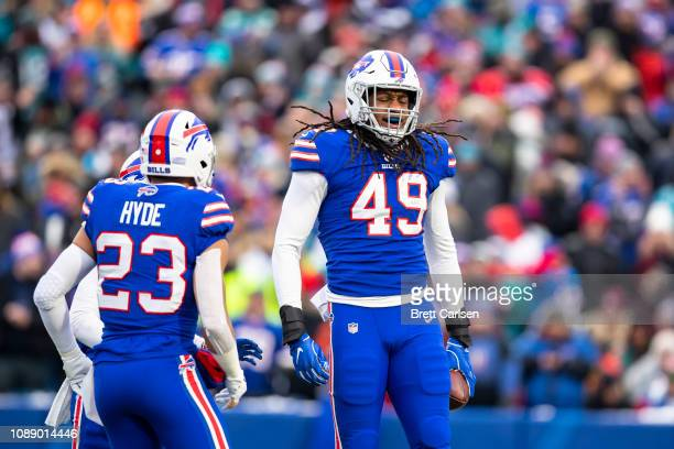 Tremaine Edmunds of the Buffalo Bills celebrates intercepting a pass thrown by Ryan Tannehill of the Miami Dolphins during the first quarter at New...