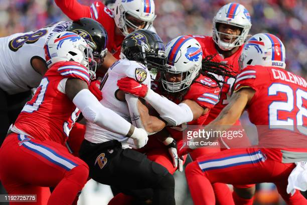 Tremaine Edmunds of the Buffalo Bills tackles Mark Ingram II of the Baltimore Ravens during the first half in the game at New Era Field on December...