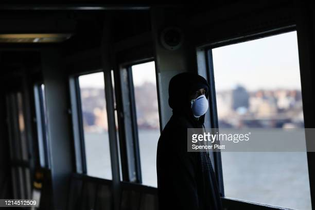 Tremaine Fredericks rides on an empty Staten Island Ferry to Manhattan on March 24 2020 in New York City Across the country schools businesses and...